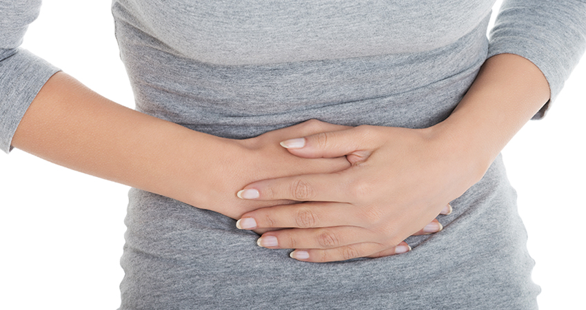 woman's stomach in pain from calcified fibroids
