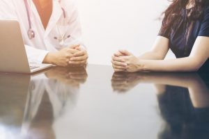 Doctor and patient consulting on a table