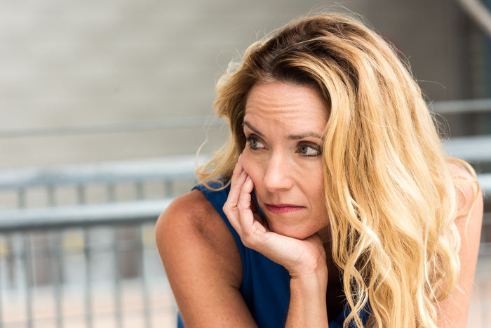Pensive Mature blond woman